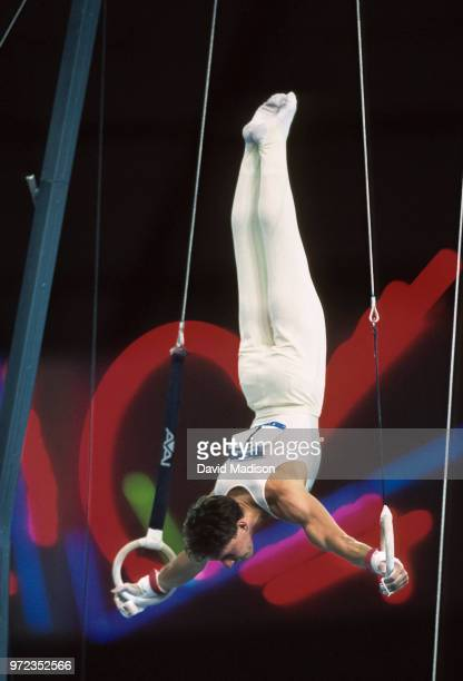 Szilveszter Csollany of Hungary performs on the still rings during the gymnastics competition of the 1990 Goodwill Games held from July 20 August 5...