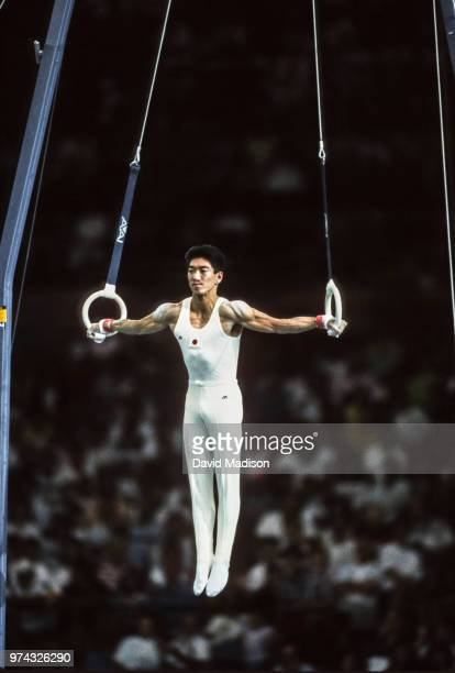 Shinji Gamou of Japan performs on the still rings during the Men's Gymnastics competition of the 1990 Goodwill Games held from July 20 August 5 1990...