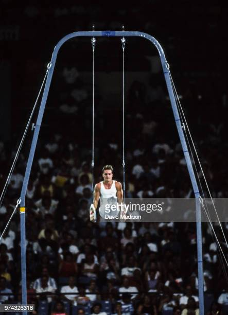 Csaba Fajkusz of Hungary performs on the rings during the Men's Gymnastics competition of the 1990 Goodwill Games held from July 20 August 5 1990 The...