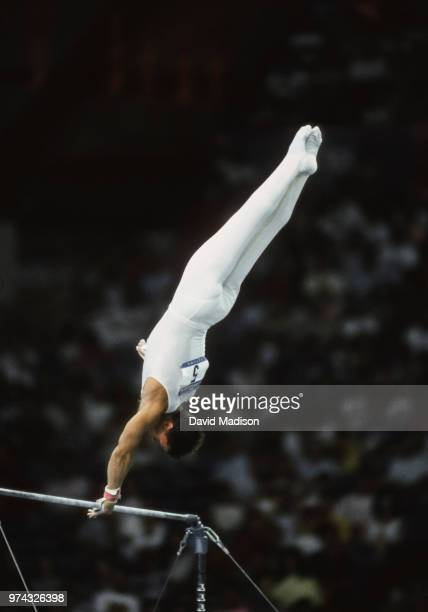 Csaba Fajkusz of Hungary performs on the high bar during the Men's Gymnastics competition of the 1990 Goodwill Games held from July 20 August 5 1990...