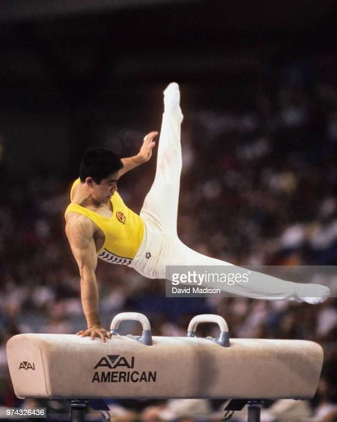 Huang Huadong of China performs on the pommel horse during the Men's Gymnastics competition of the 1990 Goodwill Games held from July 20 August 5...