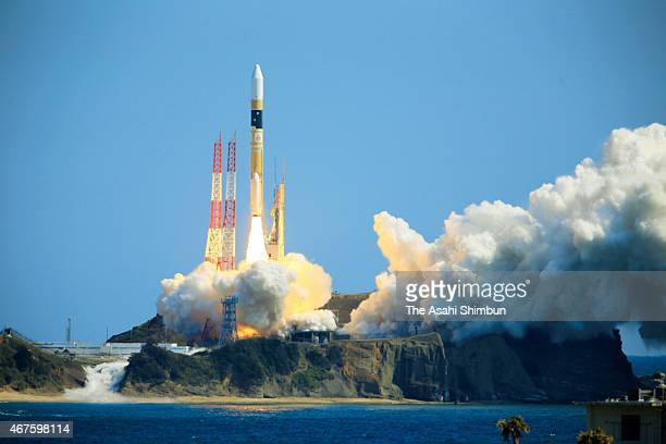 The H2A Launch Vehicle No 28 of the Japan Aerospace Exploration Agency lifts off from the launch pad at JAXA's Tanegashima Space Center on March 26...