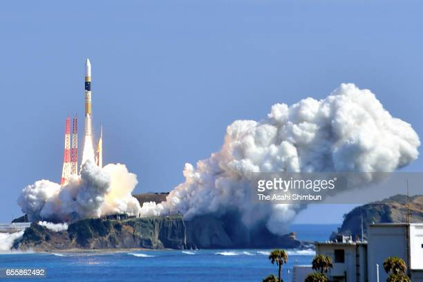 The H2A33 rocket carrying an intelligent gathering satellite lifts off from the Japan Aerospace Exploration Agency's Tanegashima Space Center on...