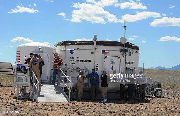 The Habitat Demonstration Unit Pressurized Excursion Module with the air lock module at left a concept offEarth living and work quarters for...