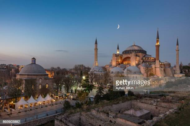 the hagia sophia and haseki hurrem turkish bath complex at night ,istanbul,turkey - hagia sophia stock pictures, royalty-free photos & images