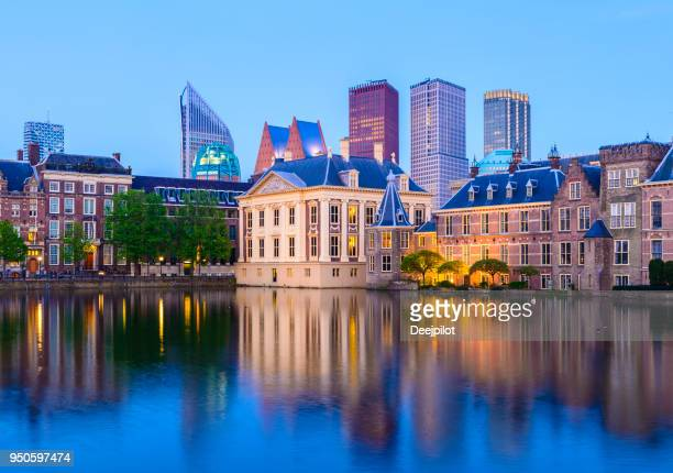 the hague downtown city skyline and parliament buildings at twilight, netherlands - the hague stock photos and pictures