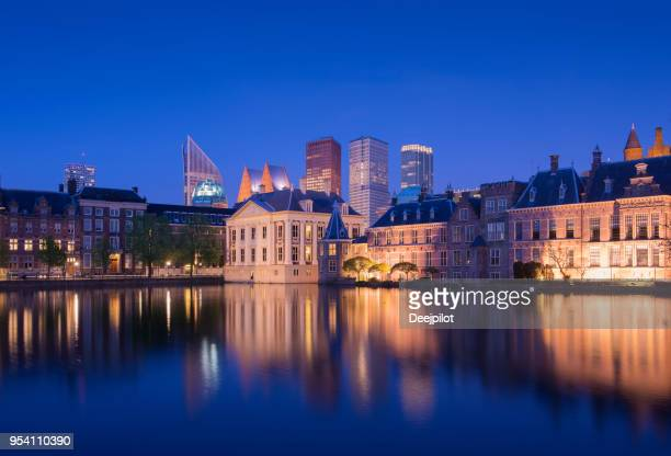 the hague downtown city skyline and parliament buildings at twilight, netherlands - the hague stock pictures, royalty-free photos & images