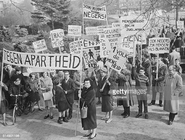 Dutch Apartheid Protest Placard waving demonstrators march through the streets here April 2nd in protest against the Sharpeville massacre in South...