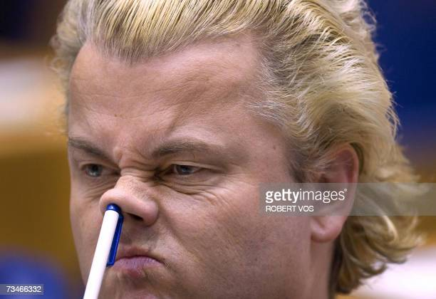 Dutch Geert Wilders leader of the parliamentary party Partij voor de Vrijheid PVV picks his nose during a parliamentary session in The Hague 01 March...