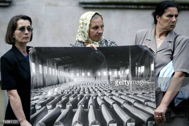 File photo taken 01 July 2004 shows survivors and relatives of victims of the Srebrenica massacre protesting in The Hague holding a picture taken 30...