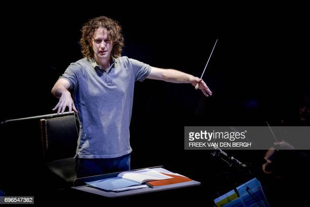 The Hague Philharmonic Orchestra's new conductor, Britain's Nicholas Collon conducts a rehearsal of the orchestra in The Hague on June 16, 2017. /...