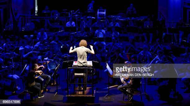 The Hague Philharmonic Orchestra's new conductor Britain's Nicholas Collon conducts a rehearsal of the orchestra in The Hague on June 16 2017 / AFP...