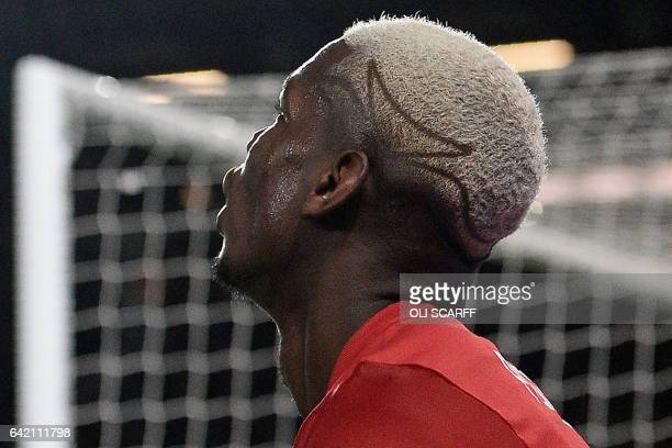 The hair of Manchester United's French midfielder Paul Pogba is pictured during the UEFA Europa League Round of 32 firstleg football match between...