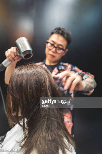 the hairdresser is fixing a girl's hair - stratum corneum stock pictures, royalty-free photos & images