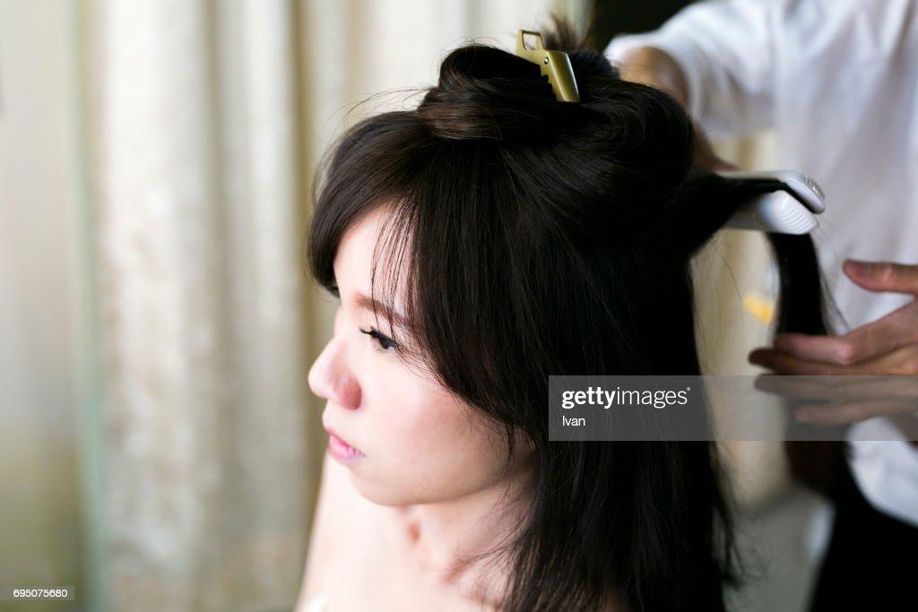 The hairdresser make the hair bun : Stock Photo