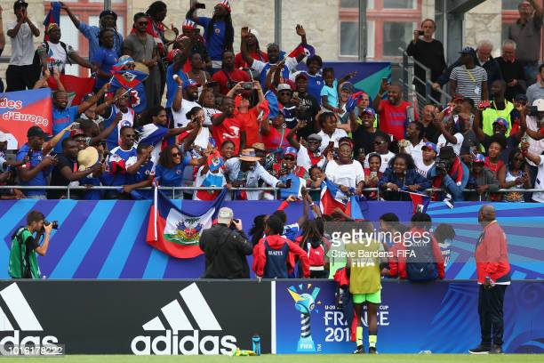 The Haiti players celebrate with their supporters after the FIFA U20 Women's World Cup France 2018 group D match between Germany and Haiti at Stade...