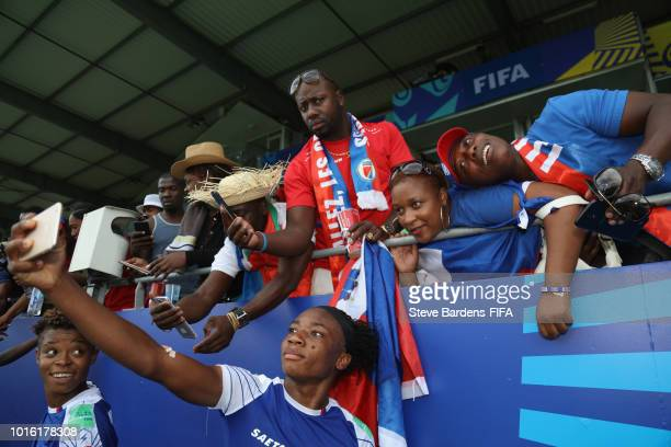 The Haiti players pose for selfies with their supporters after the FIFA U20 Women's World Cup France 2018 group D match between Germany and Haiti at...