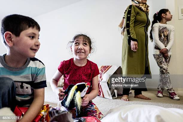 The Haji Khalif family arrives at their new home The Kurdish family of five moved here from their first placement home in Dearborn due to their...