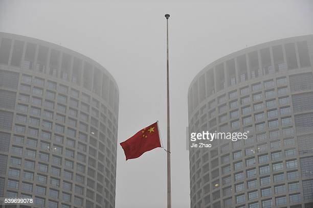 The halfmast of the Chinese national flag to mourn the victims during the April 14 Yushu Earthquake is flown in Hefei Anhui province April 21 2010 VCP