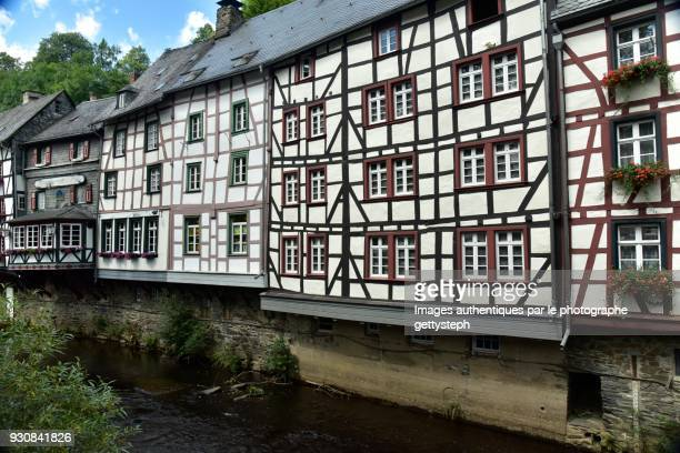 The half-timbered facades overhanging Roer River