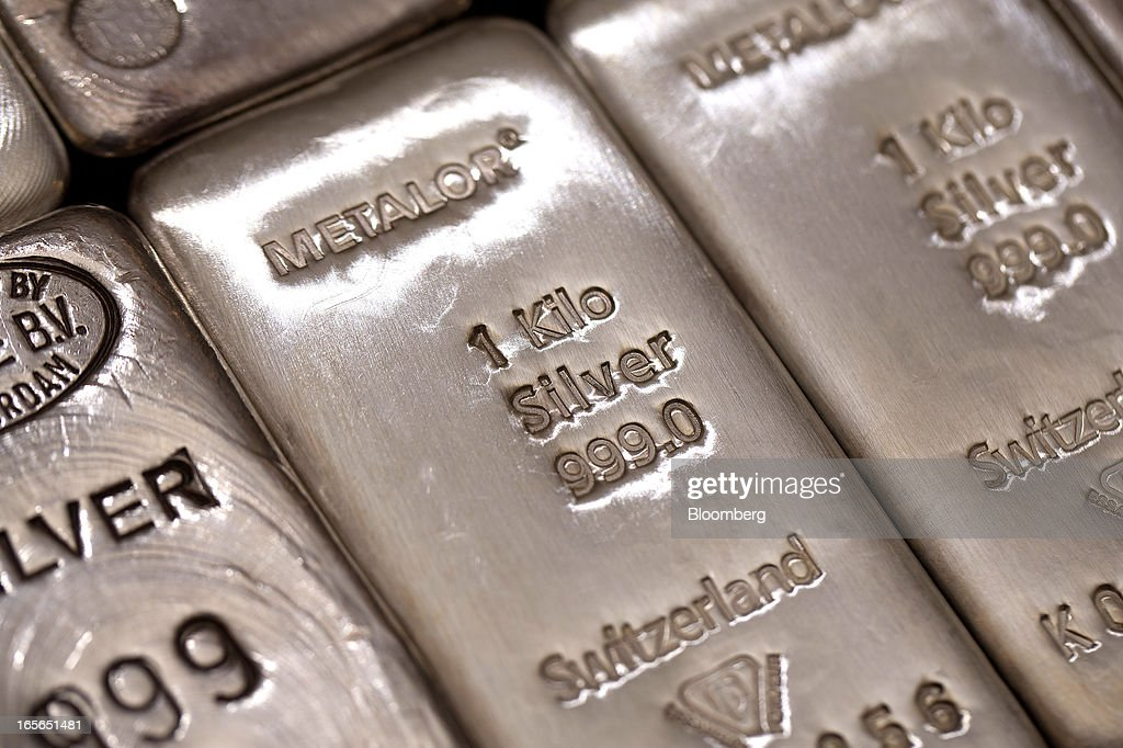 The hallmark details on one kilogram silver bars are seen at London bullion dealers Gold Investments Ltd. in this arranged photograph in London, U.K., on Thursday, April 4, 2013. Gold traders are split on whether bullion will plunge into its first bear market since 2008 as economies improve or rally as central banks buy more debt. Photographer: Simon Dawson/Bloomberg via Getty Images