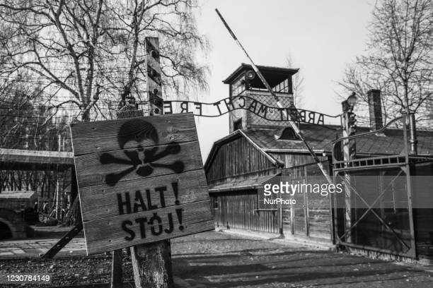 Image was converted to black and white) The 'Halt' sign by the 'Arbeit Macht Frei' entrance gate at the former Nazi German Auschwitz I concentration...