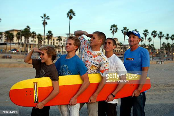 Moses Hamborg Chapman Hamborg Anders Hamborg Jachin Hamborg and Pete Hamborg hold a Classic Hamboard that is 6'8' long along the Huntington Beach...