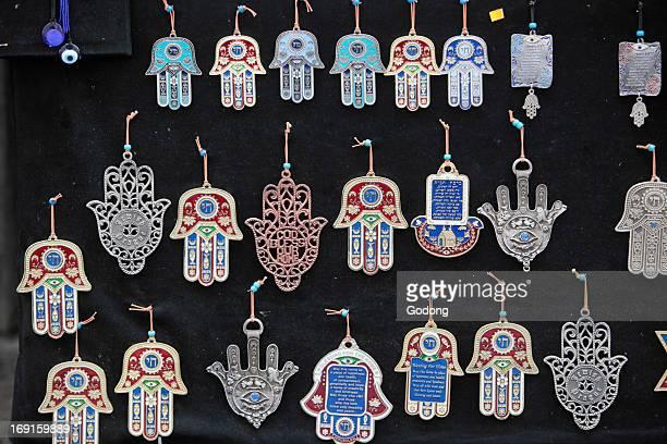 The hamesh hand or hamsa hand is a popular motif in Jewish jewelry