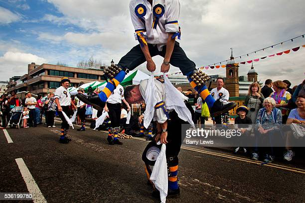 The Hammersmith Morris Men entertaining the crowds with English morris dancing on Southwark Bridge which is transformed into a giant banqueting space...