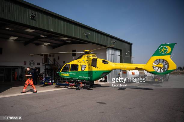 The Hampshire and Isle of Wight air ambulance helicopter is seen at Thruxton Aerodrome as members of the UK Armed Forces work with NHS medical staff...