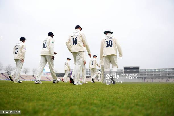 The Hampshire side make their way out for the start during Day Four of the Specsavers County Championship Division One match between Hampshire and...