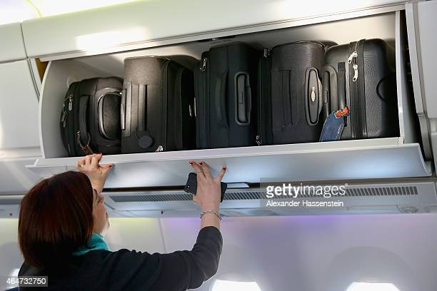 The hand baggage overhead bins in the cabin of a new Airbus A350X WB passenger plane on the tarmac at Munich Airport during a presentation of the new...