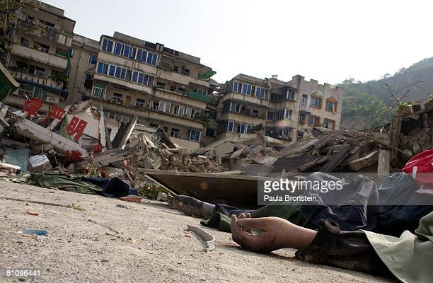 The hand of a dead body lies on the ground amongst the rubble of the earthquake ravaged town May 15 2008 in Beichuan Sichuan province China A major...