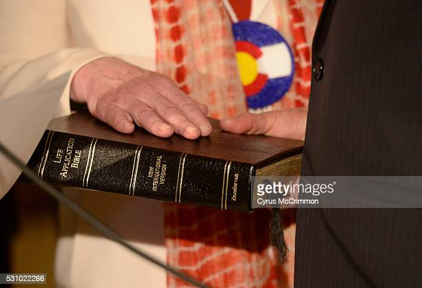 The hand of Donna Lynne rests on a bible as she was sworn in as the Lieutenant Governor of Colorado in a ceremony at the state Capitol in Denver on...