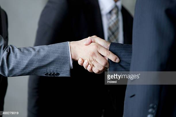 BUSINESS SCENE The hand of handshaking