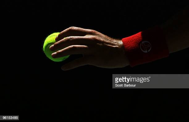 The hand of Novak Djokovic of Serbia prepares to serve in his fourth round match against Lukasz Kubot of Poland during day eight of the 2010...