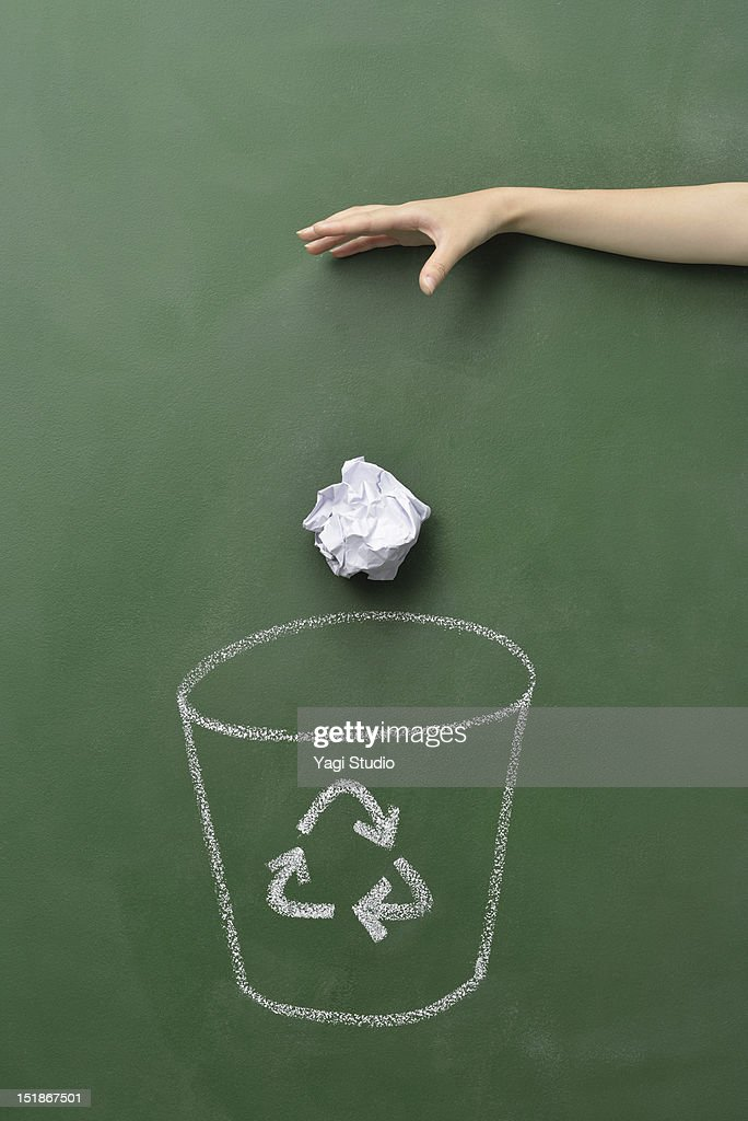 The hand which abandons a trash box and paper : Stock Photo