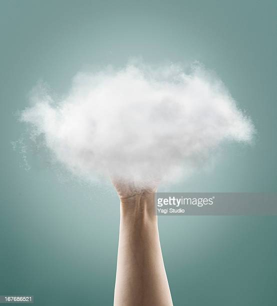 The hand which gets a cloud