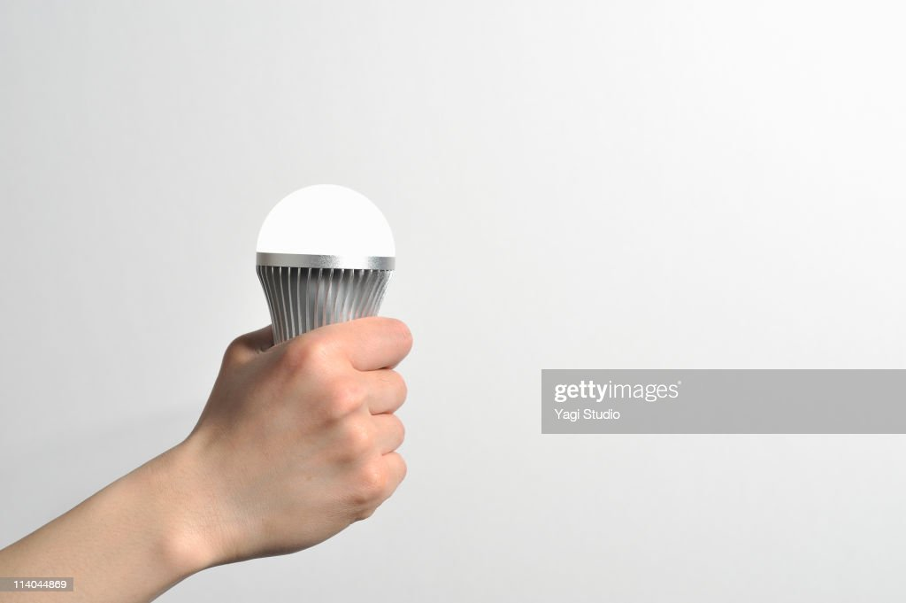 The hand which has LED light to shine : Stock Photo