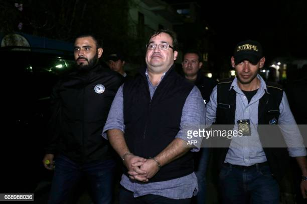 The handcuffed Javier Duarte , former governor of the Mexican state of Veracruz, is escorted by police following his arrest in Panajache...
