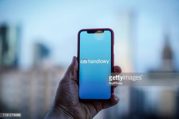 The Handlowy bank logo is seen on a mobile device in this photo illustration on March 17 in Warsaw Poland The Polish Handlowy bank is one of Poland's...