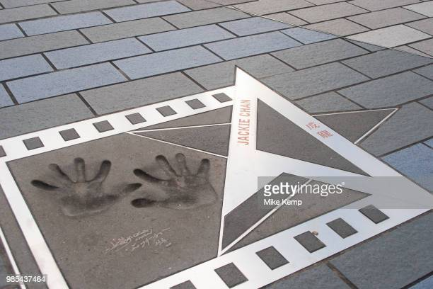 The handprints of international martial arts movie star Jackie Chan in Hong Kong China Printed into concrete on the walkway opposite Hong Kong Island...