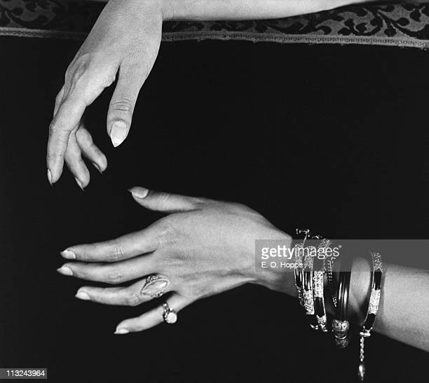 The hands of American actress Anna May Wong her fingernails filed into sharp points 1926