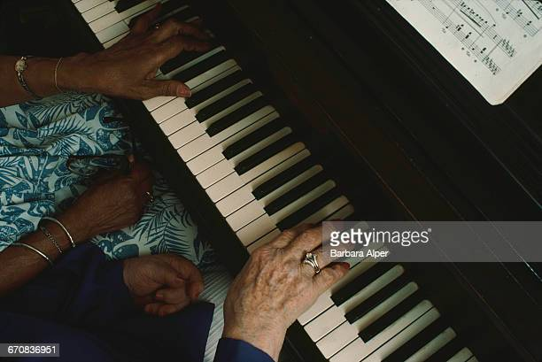 The hands of classical piano duo Margaret Patrick and Ruth Eisenberg also known as Ebony and Ivory performing in New Jersey USA June 1988 The pair...