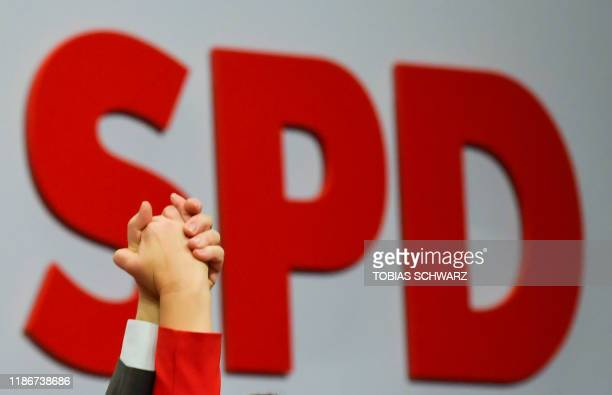 The hands of designated Germany's social democratic SPD party co-leaders Norbert Walter-Borjans and Saskia Esken are seen in front of their party...