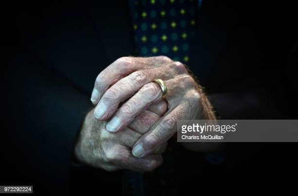The hands of former Manchester United and Northern Ireland goalkeeper and Munich air disaster survivor Harry Gregg can be seen as Prince Charles...