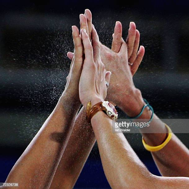The hands of Kerri Walsh and Misty May of the USA come together in celebration during the women's preliminary match on August 17 2004 during the...