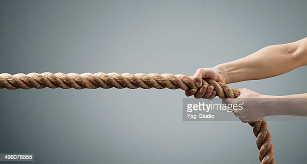 The hands of man pulling the rope