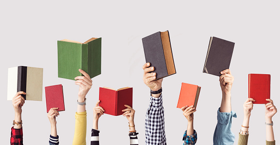 The hands of people hold books 962459768