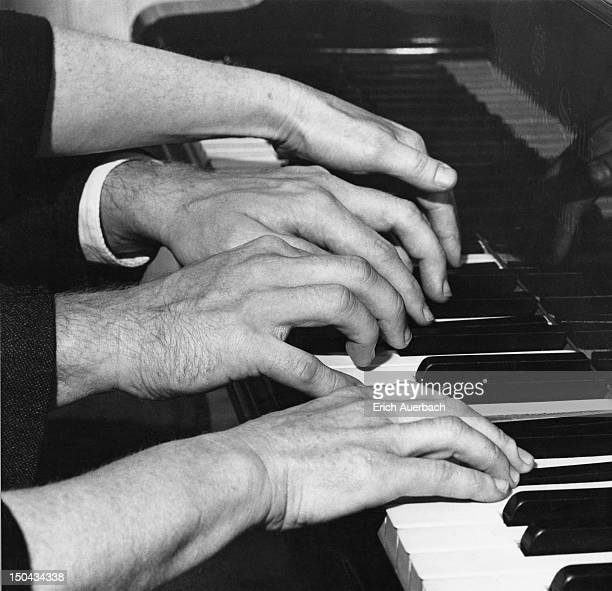 The hands of pianists Yaltah Menuhin and her husband Joel Ryce playing a work for four hands 18th October 1962